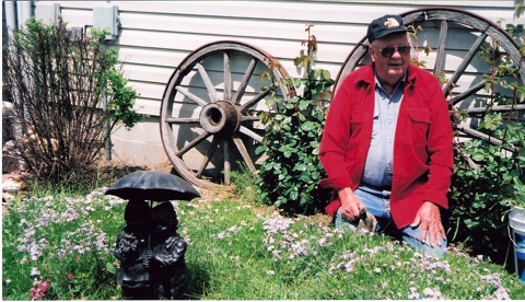 Earl Thelander getting ready to plant tomatoes